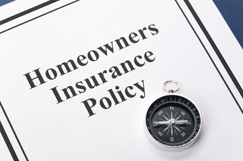 homeowner insurance policy with compass on top